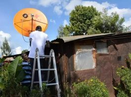 Installing a startimes satellite dish in the rural area of Kenya. Kenya is among the 25 countries that will benefit from the Access to Satellite TV for 10,000 African Villages project. (Photo Courtesy: Xinhuanet)