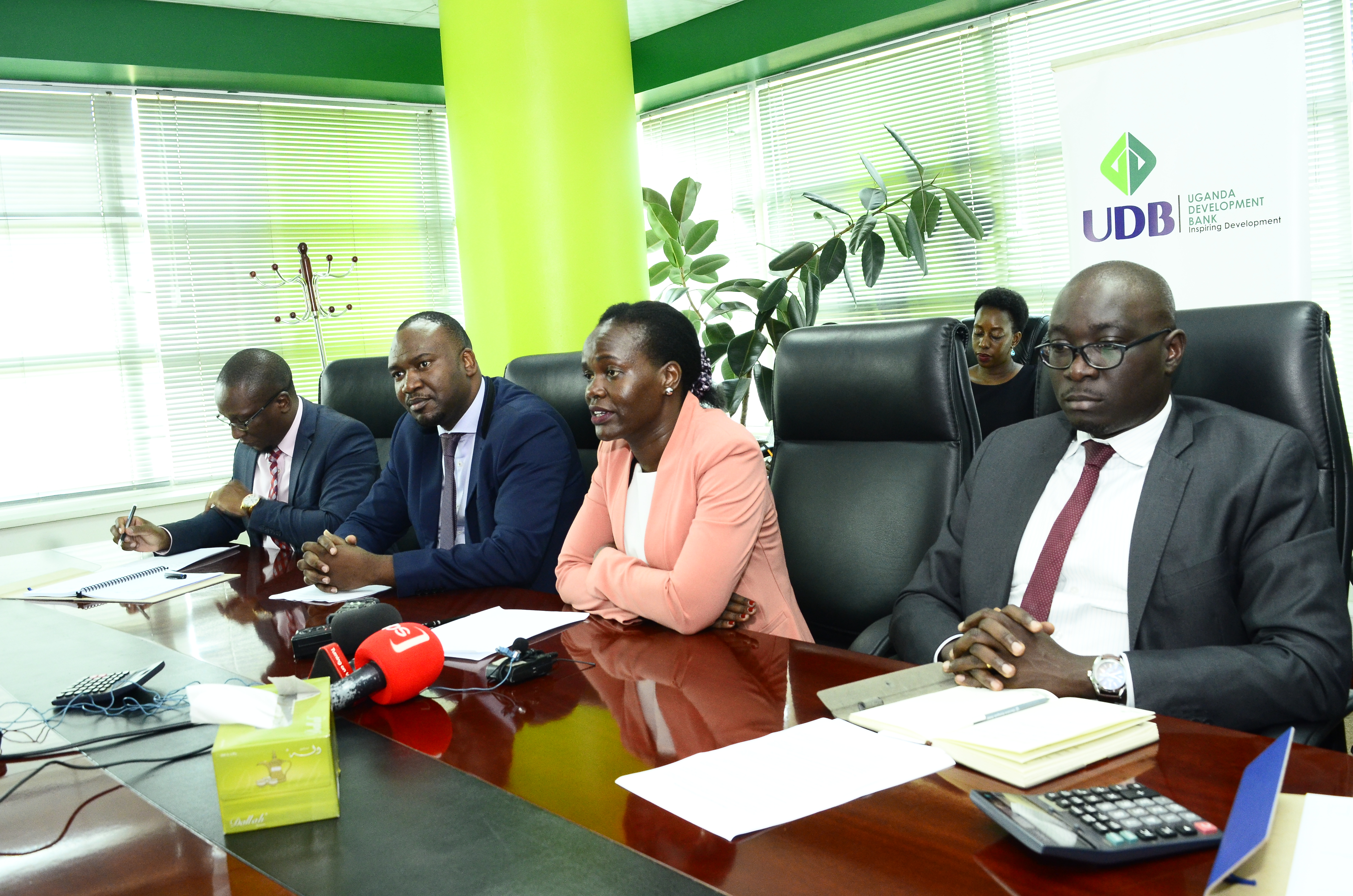 Uganda Development Bank (UDB); Managing Director Patricia Ojangole (2nd from right) makes her remarks during a press brief at the bank's offices in Kampala on Thursday 14th, February 2019.