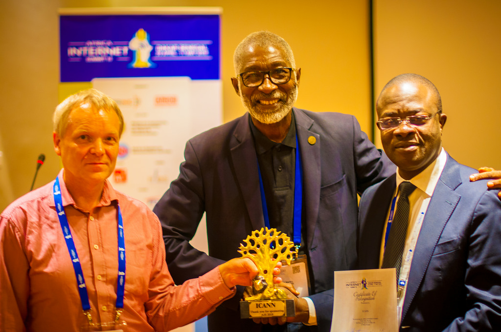 Alan Barrett (left), and Dr. Nii Quaynor (center) presenting a gift to one of the sponsors of the 2018 Africa Internet Summit in Dakar, Senegal | Courtesy Photo/ staticflickr.