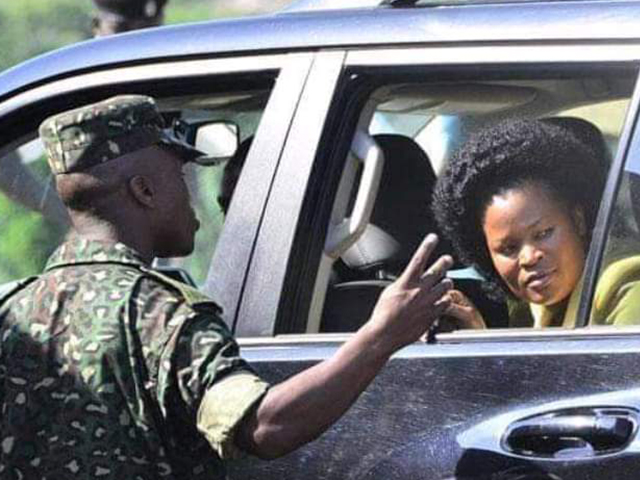 State Minister of Information Communications and Technology, Ms. Idah Nantaba pictured talking to a security personal   File Photo.