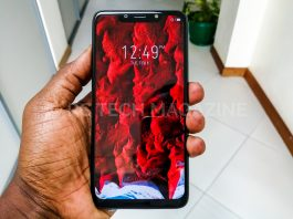 A user displays off - holding the Infinix HOT 7 smartphone   Photo by PC Tech Magazine/Olupot Nathan Ernest.