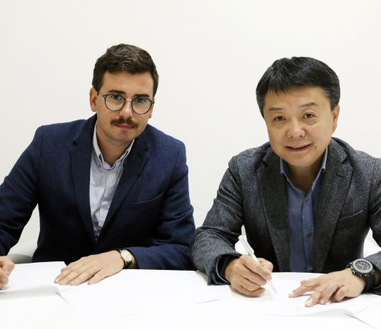 Romain Christodoulou, Senior Vice President at Jumia Group (L) and Wang Xiang, Senior Vice President at Xiaomi Inc (R) signing their partnership agreement during the Mobile World Congress 2019 in Barcelona.