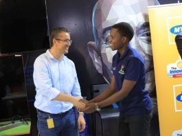 Monzer Ali; MTN Uganda acting General Manager of Mobile Financial Services greets one of the winners of the MTN API App Challenge at The Innovation Village on Friday March, 22nd 2019.