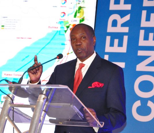 Prof Elly Karuhanda, Chairman Chamber of Mines and Petroleum making his keynote speech during the Enterprise Conference at Hotel Africana in Kampala, Uganda on Tuesday 12th, March 2019.