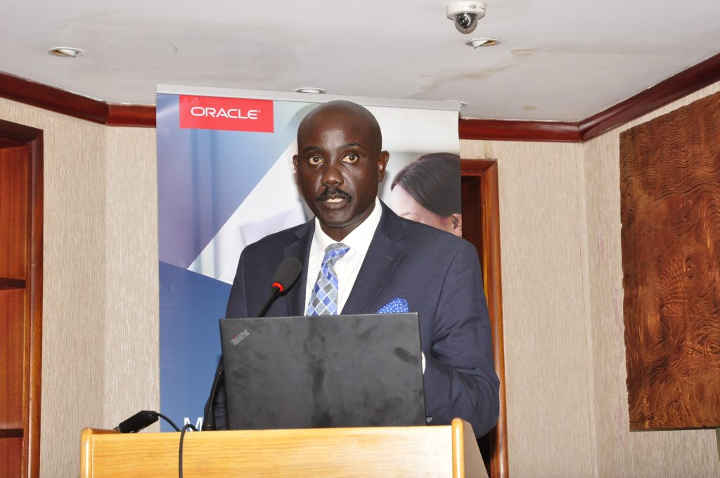 Dr. Tumubweine Twinemanzi, the Executive Director Supervision, at Bank of Uganda addressing media during the first Oracle-Raxio executive roundtable event at Serena Kampala Hotel, on March 6th 2019.