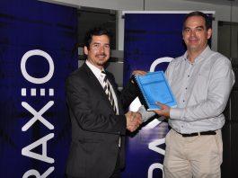 Raxio Director Robert Mullins (left) and Mark Koehler, the Roko Construction Managing Director, exchange signed contracts.