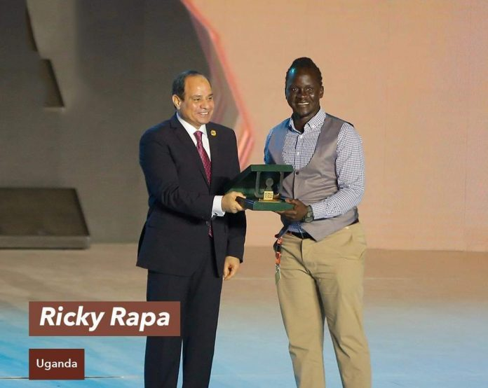Safeboda Co-Founder, Rapa Thomson Ricky receiving a honor accolade from the President of Egypt, H.E Abdel Fattah el-Sisi during the 2019 World Youth Forum in Egypt | File Photo.
