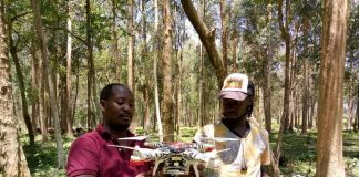 Jaguza Founder and Chief Executive, Ronald Katamba (red t-shirt) pictured holding a drone before test flying it | Courtesy Photo/Jaguza.
