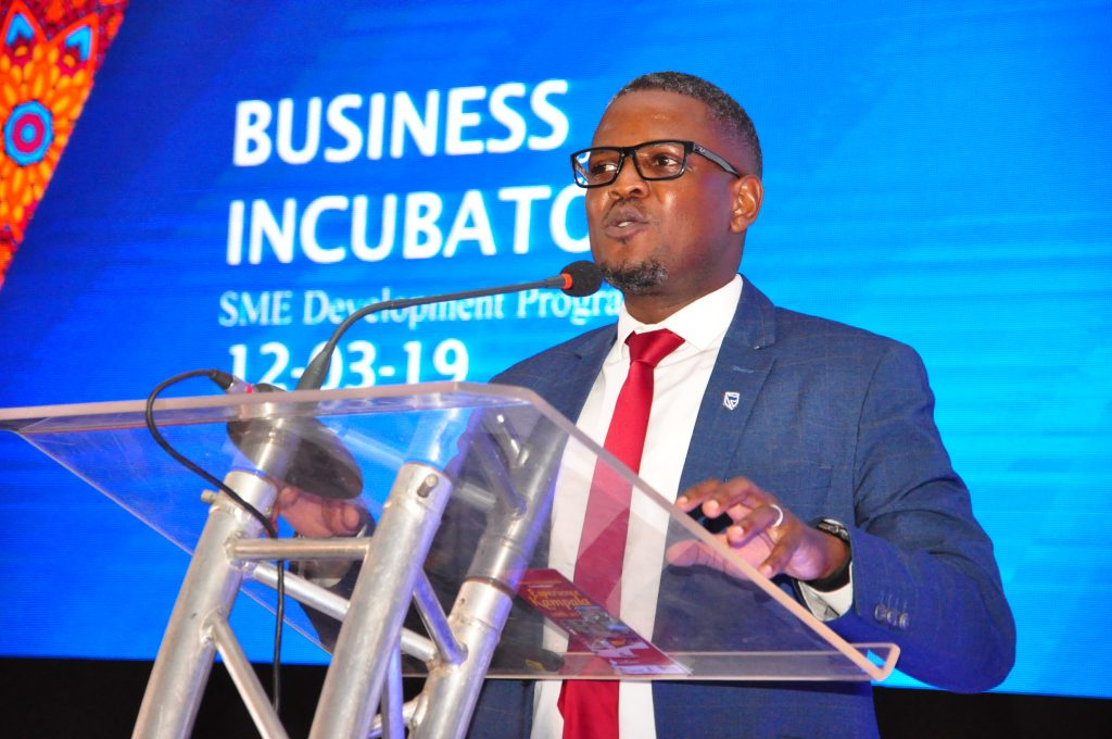Mr Tony Otoa O the Stanbic Head of Business Development makes a presentation during the Enterprise Conference at Hotel Africana in Kampala, Uganda on Tuesday 12th, March 2019.