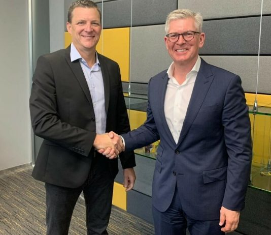 Rob Shuter, CEO and President of MTN Group (R) with Borje Ekholm, President and CEO of Ericsson (L) shake hands at the Mobile World Congress 2019 in Barcelona | Courtesy Photo.