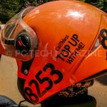 "Safeboda riders permitted to sale credit to their customers have a sticker that reads ""Cashless Top With Me"" on their helmet 