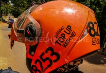 """Safeboda riders permitted to sale credit to their customers have a sticker that reads """"Cashless Top With Me"""" on their helmet 