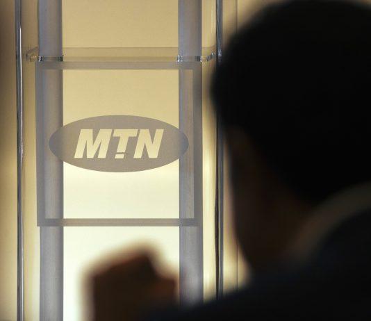 MTN logo seen in a shilloute shot | Photo By: Waldo Swiegers/Bloomberg.
