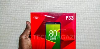 A consumer pictured holding the new itel P33 with its seal on after the launch | Photo by PC TECH MAGAZINE/Olupot Nathan Ernest.