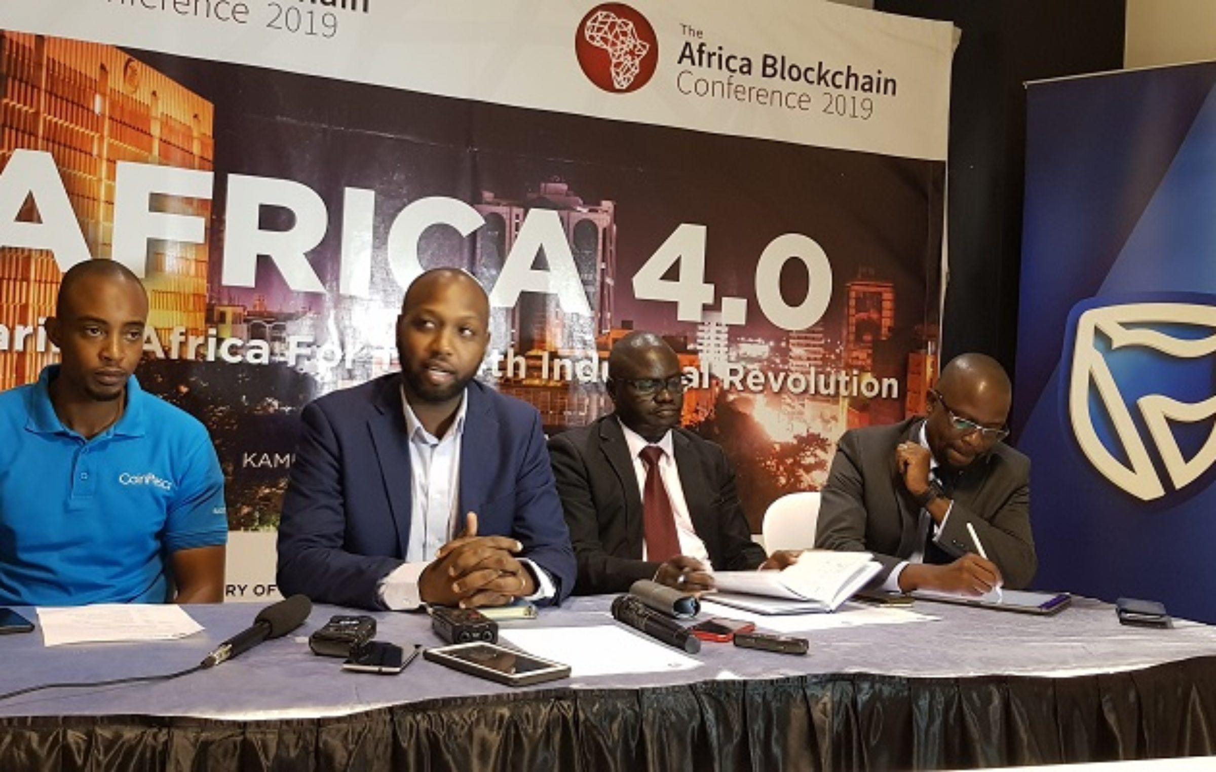 From L-R: Suleiman Murunga, CEO CoinPesa; Julius Torach, a commissioner in Ministry of ICT; Herbert Olowo, the CIO Stanbic Bank Uganda, and CryptoSavannah CEO, and Chairperson of the Africa Blockchain Conference, Kwame Rugunda addressing journalists on Tuesday May, 14th 2019 at Nakawa House. File Photo/SautiTech
