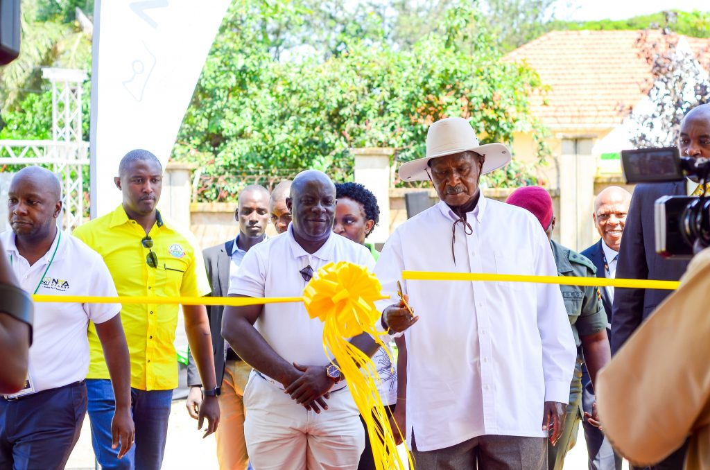 President Yoweri Museveni cutting the ribbon officially launching the National Tier 3 Data Center in Jinja on Thursday June, 12th 2019.