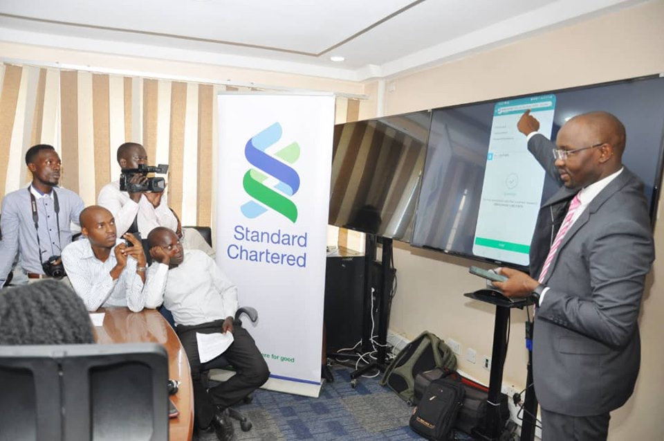 Mr. Innocent from Standard Chartered Bank demonstrating to the press how their newly SC Keyboard works.
