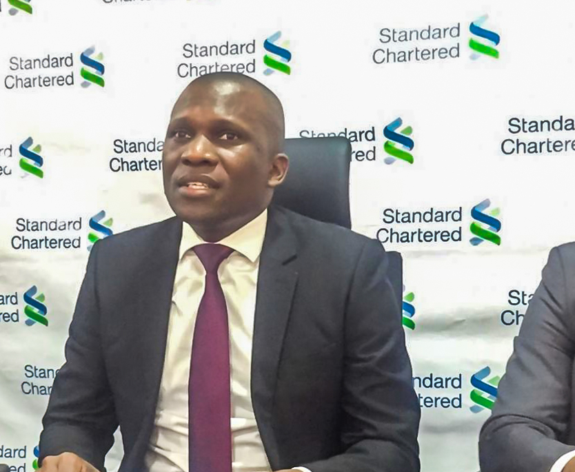 Moses Rutahigwa; Standard Chartered Bank Head of Retail Banking briefing the press about their newly launched SC Keyboard.