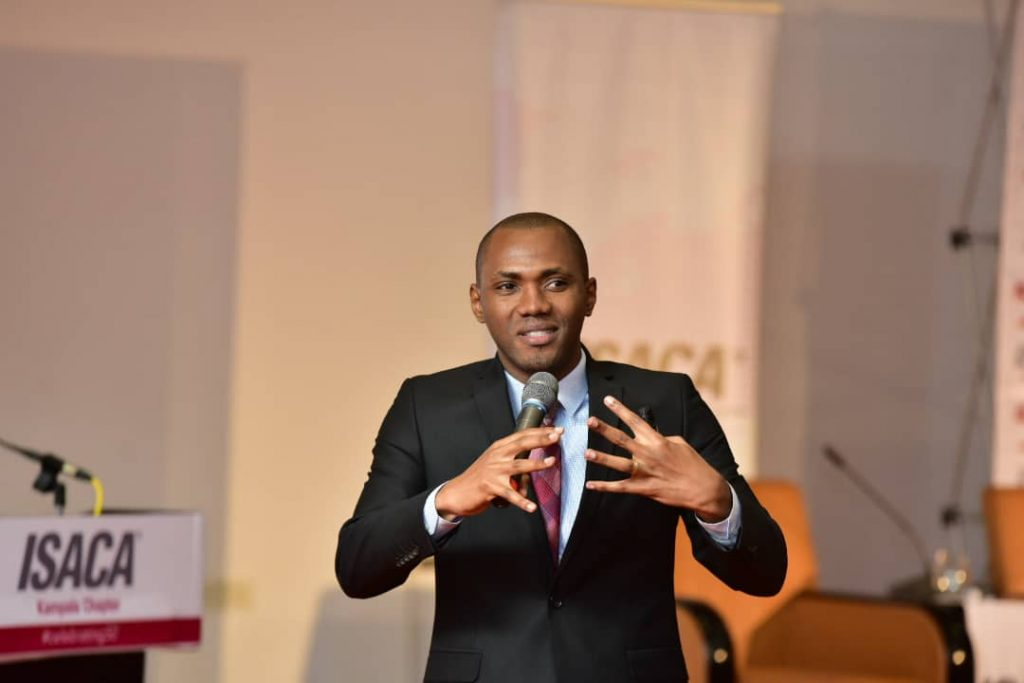 Peter Ojekunle; Manager IT Risks Assurance at PwC Uganda sharing insights on artificial intelligence & continuous auditing at the ISACA Information Security Conference in Kampala.