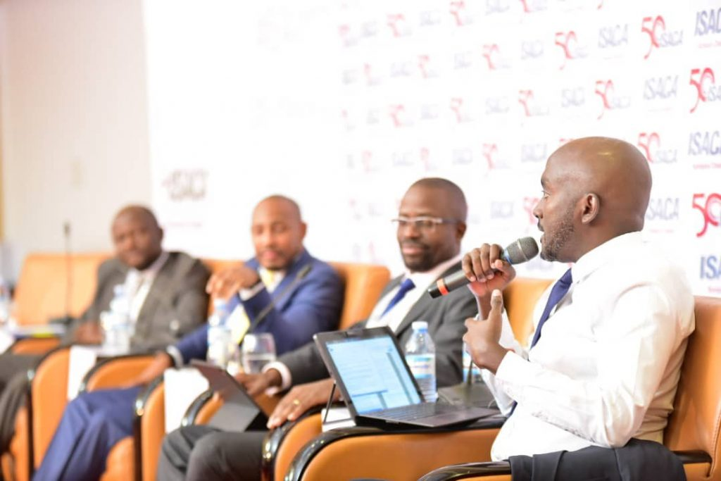NITA-Uganda Marketing and Communications Manager; Mr. Steven Kirenga chairs a panel discussion of digital services and how best to roll it, at the ISACA Information Security Conference in Kampala.