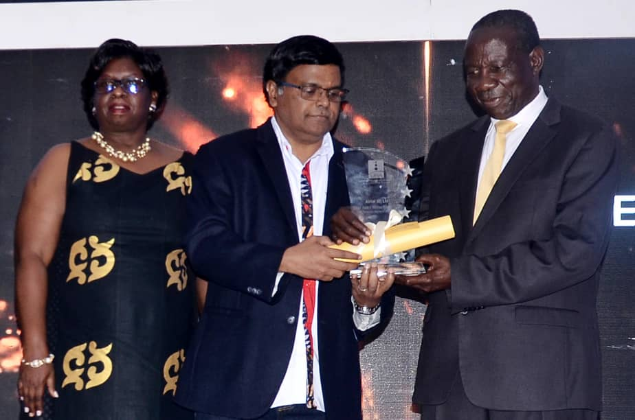 V.G. Somasekhar; Managing Director Airtel Uganda receiving the Excel Award from Minister of Finance Hon. Matia Kasaijja as the top contributor of Uganda's tax.