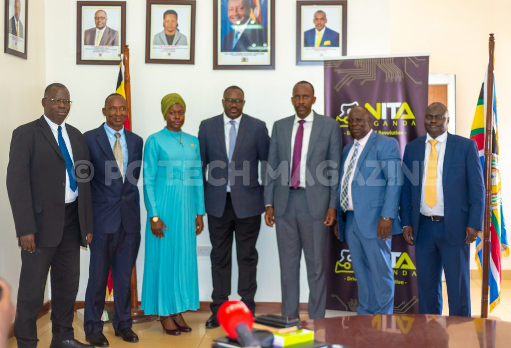New board of directors NITA Uganda (L-R); Dr. Albert Richards Otete, Hon. James Kabajo Kyewalabye, Dr. Amina Zawedde, John R. Musinguzi, James Saaka and Julius Peter Torach pose for a photo with Hon. Vincent Waiswa Bagiire (centre) after swearing in.