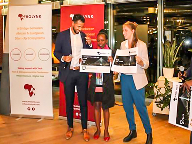 Ms. Vaolah Amumpaire; Wena Hardware CEO and Founder (center) receiving the reward of outstanding innovation at Afrolynk for Wena Hardware. Courtesy Photo.