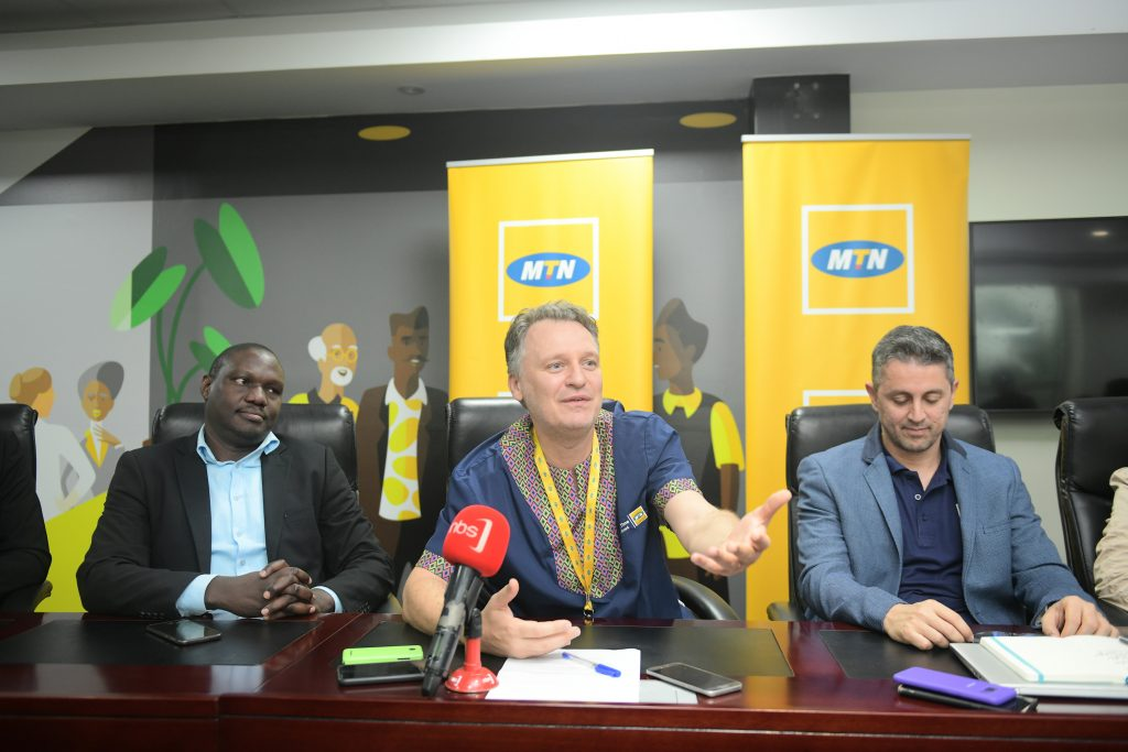 MTN Uganda CEO, Mr. Wim Vanhelleputte (c) addressing reporters before awarding winners of the MTN mobile money Open API challenge at their head offices in Nyonyi Gardens on Friday, 31st January 2020.
