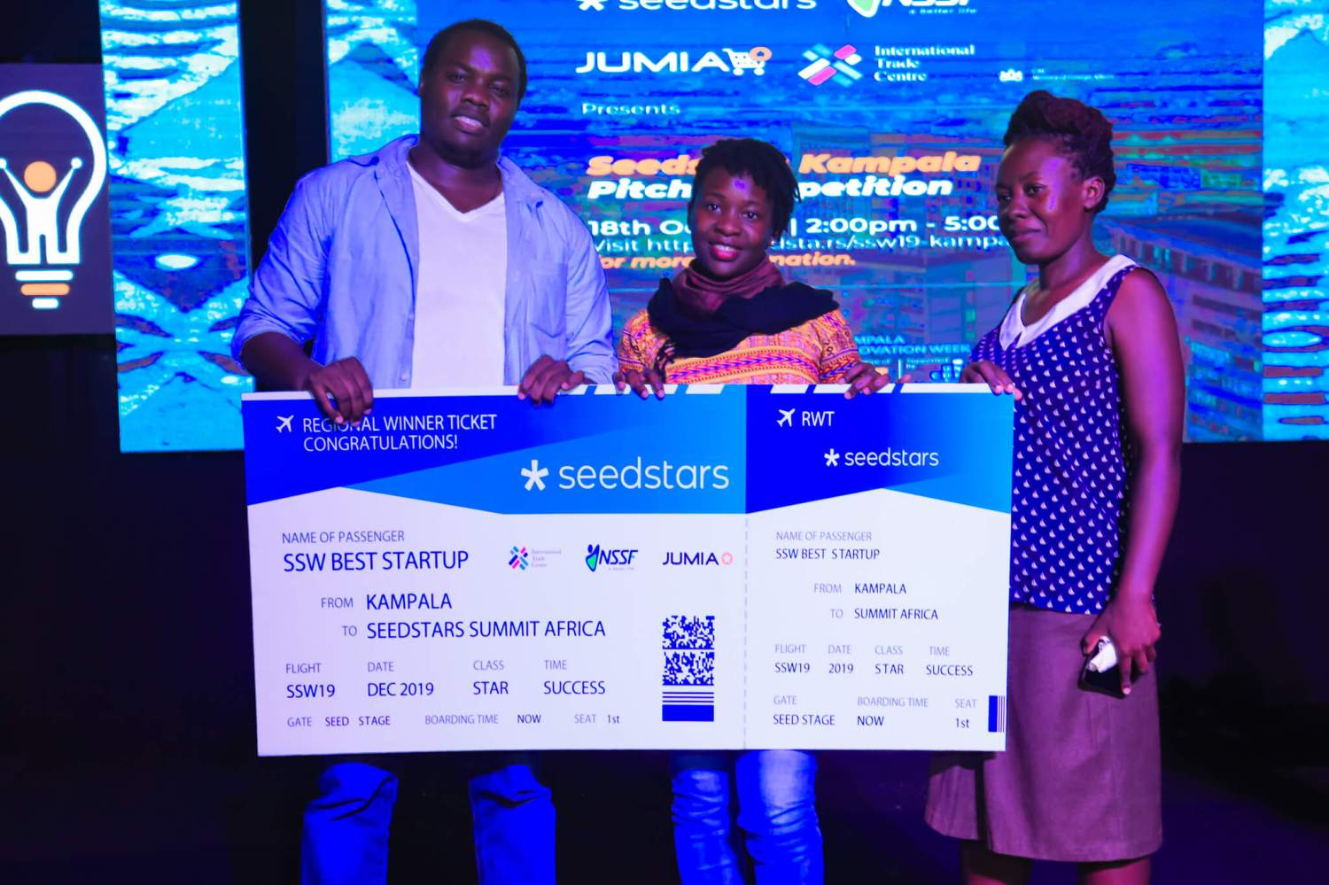 Teheca team led by its CEO Ruyonga Daniel (left) holding a dummy ticket to the Seedstars regional competition. The team will travel to Switzerland for the global competition. Courtesy Photo.