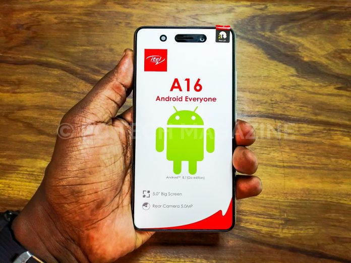 A consumer displays an itel A16 smartphone that can cost about UGX150,000 or less. Photo by: PC TECH MAGAZINE/Olupot Nathan Ernest.