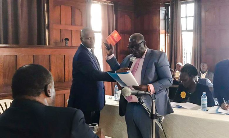 National Information Technology Authority (NITA) Executive Director, Mr. James Saaka swearing in a new board member of NIRA. Courtesy Photo