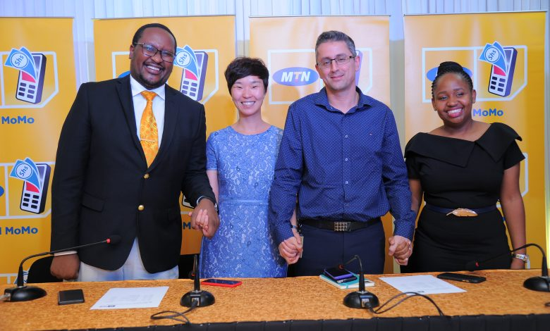 The various representatives after launching the money remittance platform between MTN Uganda and Vodacom Tanzania on Tuesday 25th, Feb. 2020. File Photo