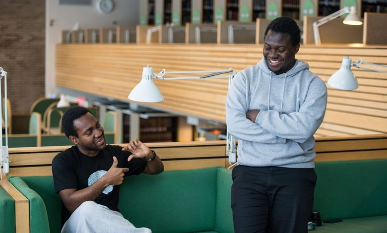 Chipper Cash founders; Ugandan Ham Serunjogi (R) and Ghanaian Majid Moujaled (L) share a light moment together. (Courtesy Photo)
