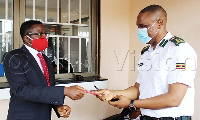 Katikiro of Buganda Kingdom; Charles Peter Mayiga receiving his e-passport from Internal Affairs. Photo by | Lawrence Mulondo, Journalist with The New Vision.
