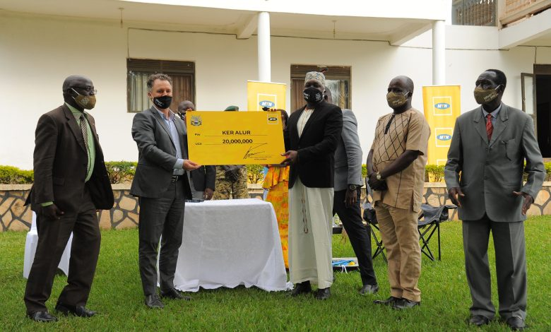 MTN Uganda Chief Executive Officer, Mr. Wim Vanhelleputte (2nd from left) handed over the UGX20 million cheque to the kingdom officials to support the coronation celebrations that are set to take place in Zombo on October 31st 2020.
