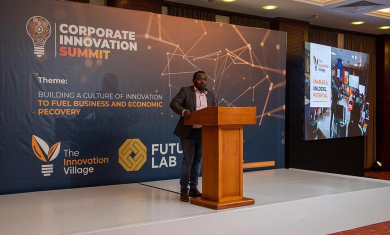 The Innovation Village Team Lead CK Japheth speaking during the inauguration of the Corporate Innovation Summit at the Kampala Serena Hotel.