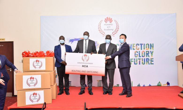 From Left to Right: Dr. Justus Kwetegeka, Dean Kyambogo, Hon. Bagirre Vicent Waiswa, Permanent Secretary Ministry of ICT and National Guidance, Prof John Chresestom Maviri, VC Uganda Martrys Nkozi University and Mr. Gaofei, Huawei MD with a demo of the donated equipment