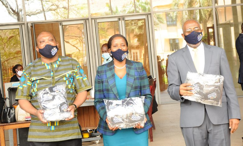In Pictorial from L-R: South African High Commissioner Lekoa Solly Mollo, Ms Anne Juuko Chief Executive Officer of Stanbic Bank and the Prime Minister of Uganda Ruhakana Rugunda pose for a photo after FOSABU handing over Covid-19 PPE worth UGX100 million.