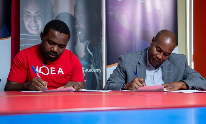 CK Japheth (L), the Team Lead at The Innovation Village and CEO CIT Institute of Technology, Da'shone Hughey (R) pictured signing their partnership. (Courtesy Photo)