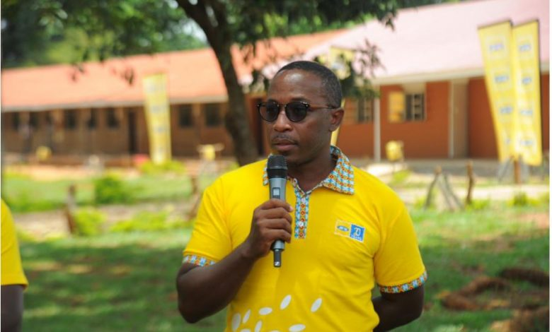 Bryan Mbasa, the Senior Manager MTN Uganda Foundation speaking at the hand over of the 10-classroom renovated block at Busia Secondary School.